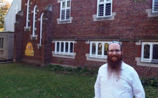 Rabbi Yisroel Bernath in front of Chabad-NDG, housed in a former church.