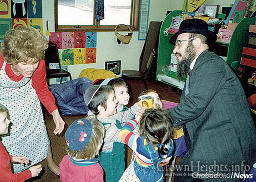 The Fellers help children in the cheder perform the mitzvah of tzedakah.