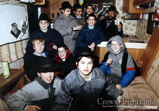 "Feller with a group of cheder students in a ""mitzvah tank,"" getting ready to bring a little Jewish warmth into the Minnesota cold."
