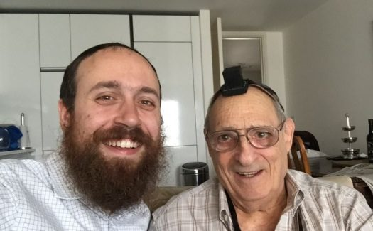 Rabbi Mendy Korer (l) with Samuel Lyons (r) after the bar mitzvah boy laid tefillin.