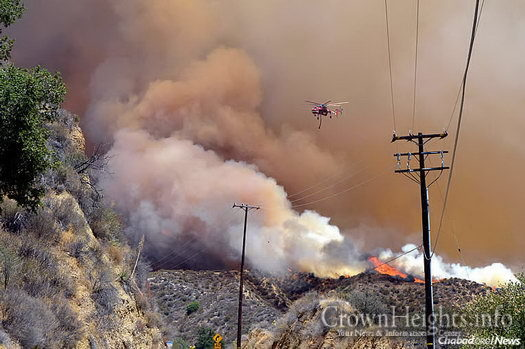 "The ""Sand Fire"" on Monday, four days into the blaze that has claimed at least one life, destroyed 18 homes so far and burned more than 38,000 acres in the Santa Clarita Valley mountains. (Photo: InciWeb)"