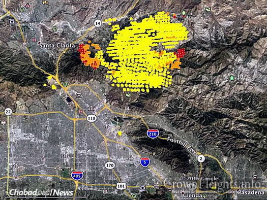 "A map shows heat detected from the ""Sand Fire"" by a satellite. The red dots were current as of Monday afternoon. At that time, the fire was actively spreading east of Santa Clarita and Highway 14, as well as to the west. (Photo: Wildfire Today)"
