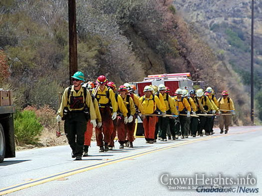 "Crews head out to face the blaze. Some 2,700 personnel have been battling the ""Sand Fire,"" and another 3,500 people are fighting the ""Soberanes Fire."" (Photo: InciWeb)"