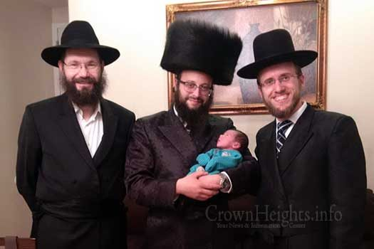 Shimon Klein holds his son Menachem Mendel last Motzoei Shabbos after his son's bris, flanked by the mohel, Dr. Hershel Greenberg (left), and a friend, Naftoli Davidowitz.