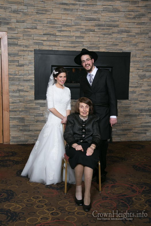 Rabbi Avremi Zippel and his bride with his grandmother on his wedding day