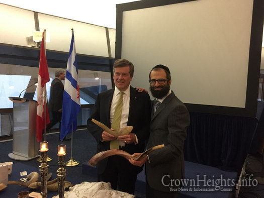 Rabbi Yirmi Cohen and Mayor of Toronto John Tory.