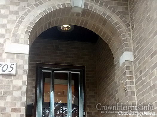 Three of four doors one needs to pass through in order to enter this Chicago home (the brick arch is outside at the entryway).