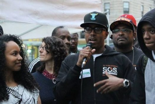 Lavon Walker speaks at an event for Save Our Streets (SOS) in Crown Heights.