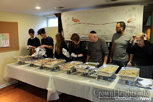 Volunteers of all ages serve the meal at Chabad of Hunterdon County.