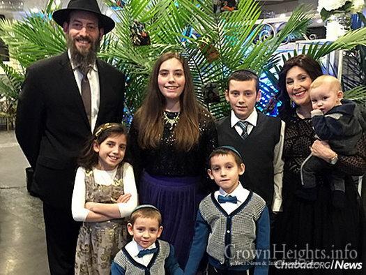 Rabbi Eli and Rachel Kornfeld, and family