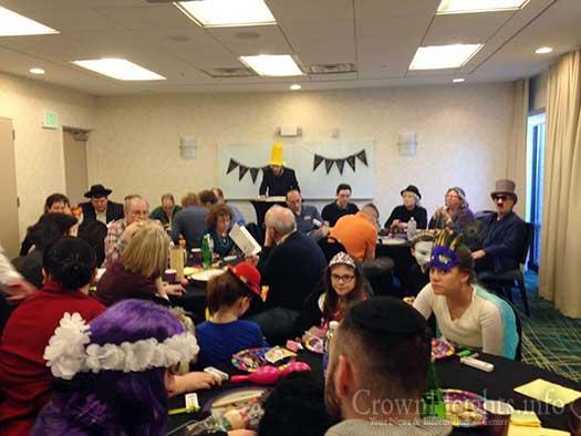 Rabbi Mendel Alperowitz reading the Megillah for some 45 people this past Purim in South Dakota.