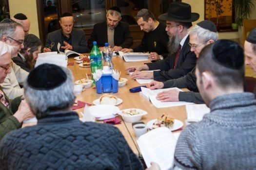 File photo: Rabbi Krinsky conducts a Torah study session with local Jews.