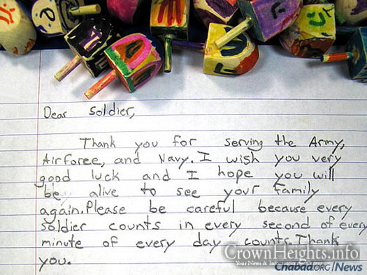 Letters from kids thanking U.S. soldiers accompany Chanukah items such as menorahs, candles, dreidels and chocolate coins.