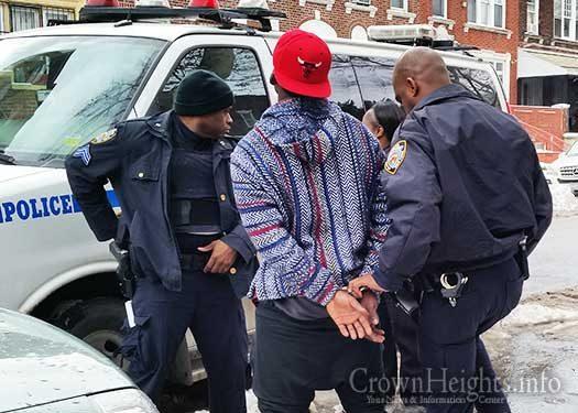 A suspect is taken into custody. Illustration Photo.