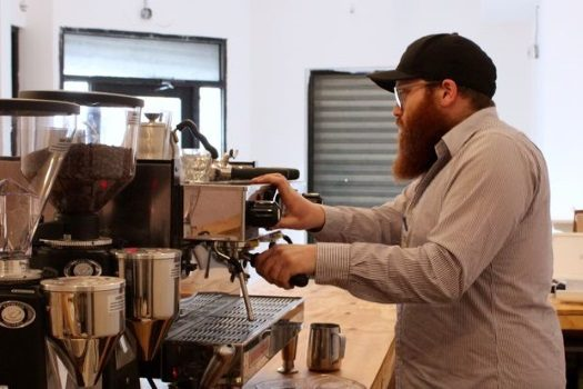 Zalmy Mochkin, proprietor of the Dean Street Cafe, makes and espresso for a friend at his new cafe at 87 Utica Ave. in Crown Heights. Photo: DNAinfo/Rachel Holliday Smith.