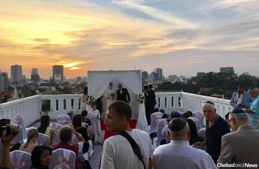 As the sun set over Phnom Penh, locals, tourists and guests from all over the world gathered for the first Jewish wedding known to be celebrated in the Kingdom of Cambodia.