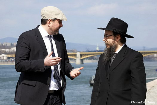 Csanád Szegedi, left, was a Hungarian Neo-Nazi leader until he discovered his Jewish roots. Here, he stands with Chabad-Lubavitch Rabbi Boruch Oberlander on the banks of the Danube River, where hundreds of Hungarian Jews were shot between 1944 and 1945.
