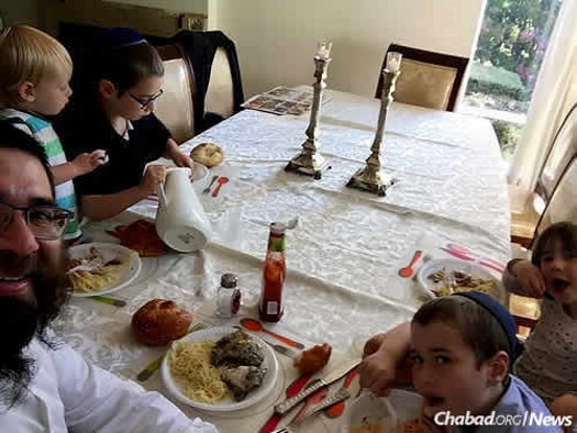 "Rabbi Menachem Lipskier of Melbourne, Australia: ""My wife will be gone for more than a week. It's times like these when husbands realize how much our wives do every day for our families."" Here while mom was away father and children prepared for a special meal celebrated each year in honor of their ancestor, 'The Shpole Zaide."""