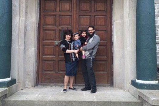 Rabbi Zalmi and Patsonia Lipinski with their two daughters, standing outside Tempo Gabriel in Mar del Plata, Argentina.