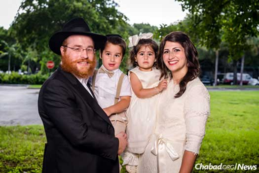 Rabbi Yossi Bendet, the day school's director of development, and Mushky Bendet, a teacher at the school, with their children.