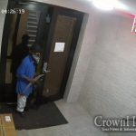 Shocking Photo of Thief Entering Building in Crown Heights Holding a Machete